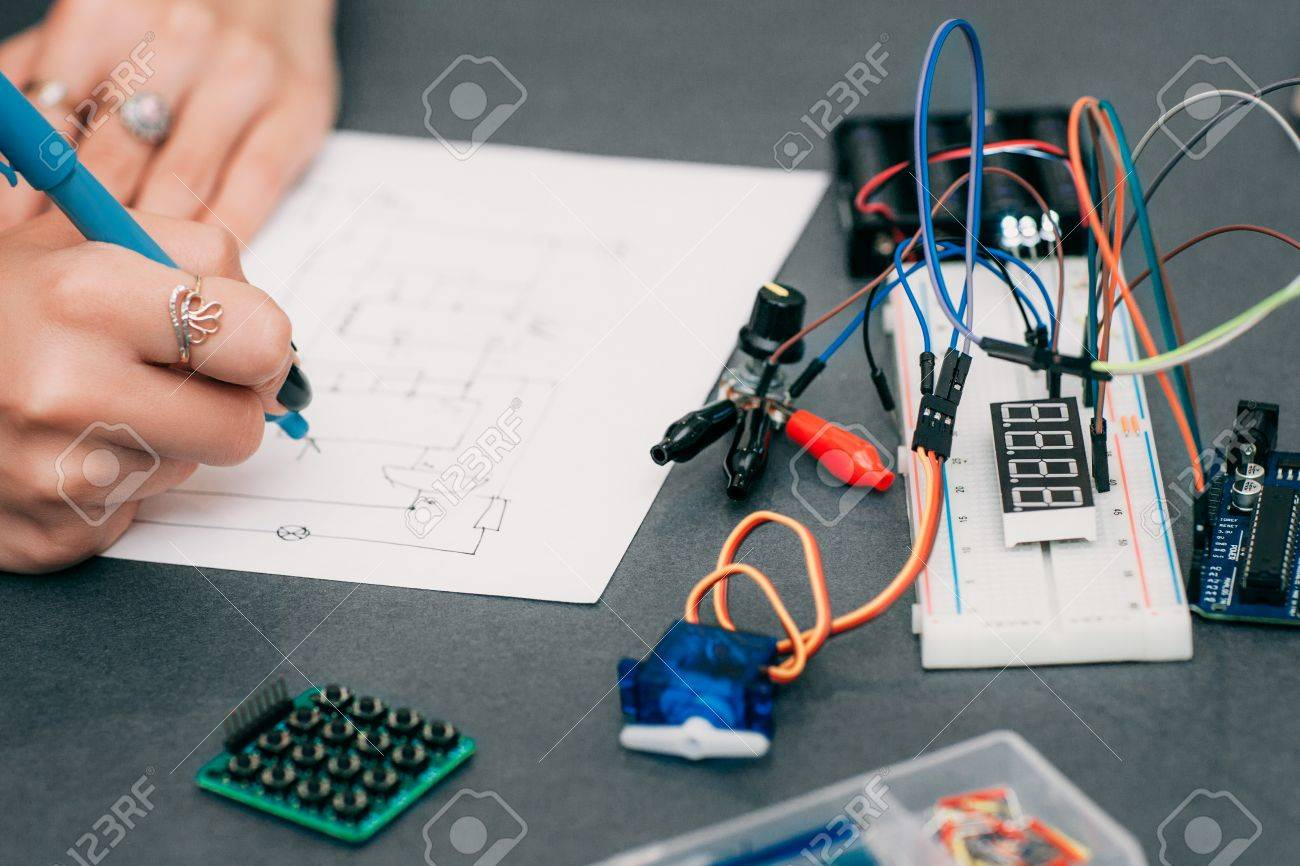 hight resolution of stock photo wiring diagram drawing with breadboard electronic construction developing female engineer in