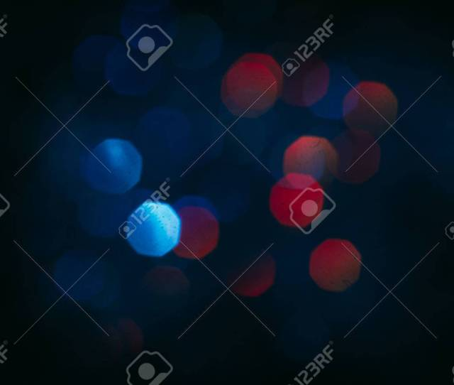 Abstract Blurred Glittering Shine Teal And Red Blur Light Bokeh Night Background