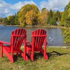 Red Adirondack Chairs Best Desk Chair For Sciatica Two On A Lake Shore Sunny Autumn Day Stock Photo
