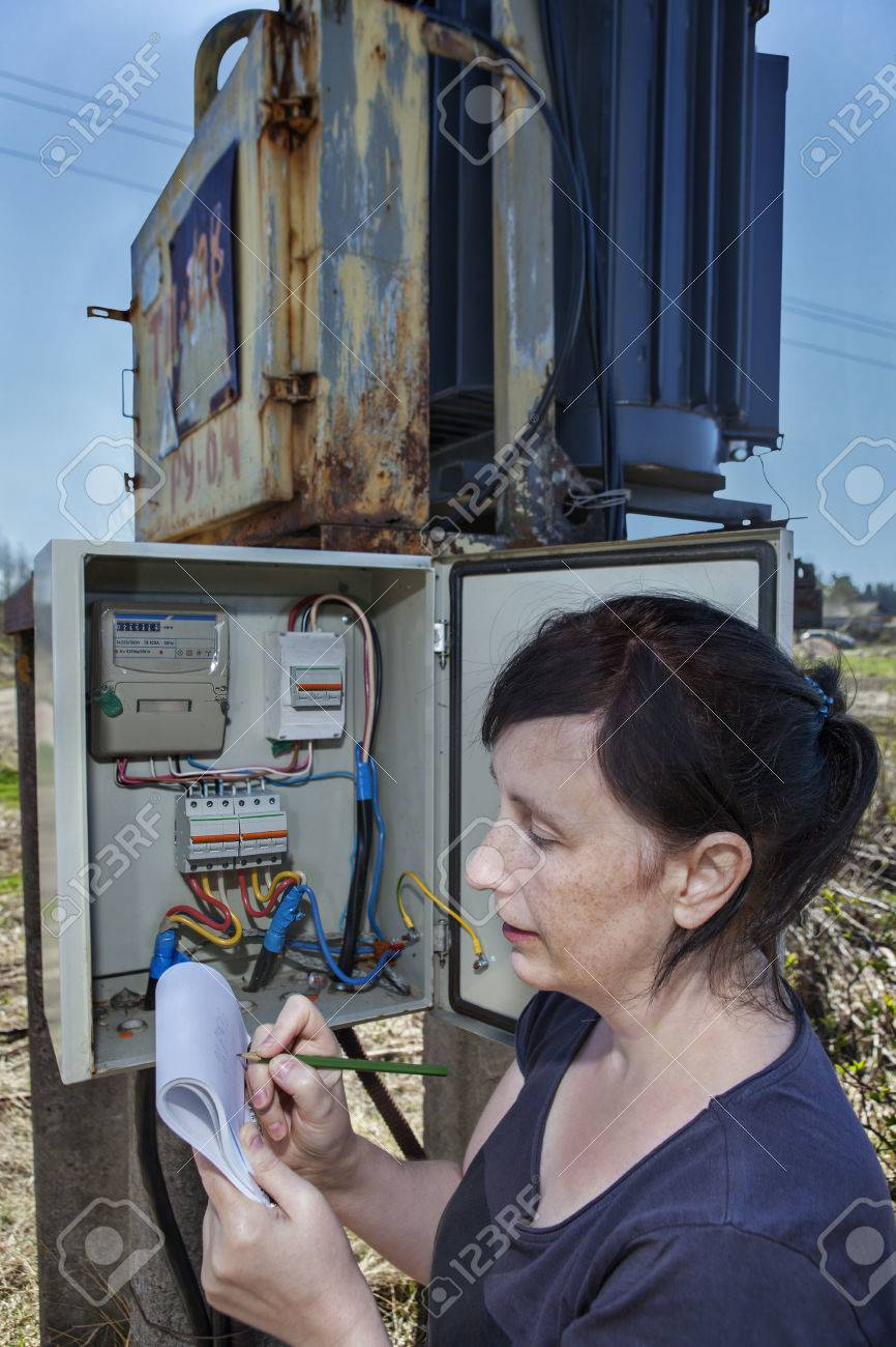 medium resolution of stock photo woman electrician engineer inspecting electric counter equipment in distribution fuse box electricity switchgear power transformer substation