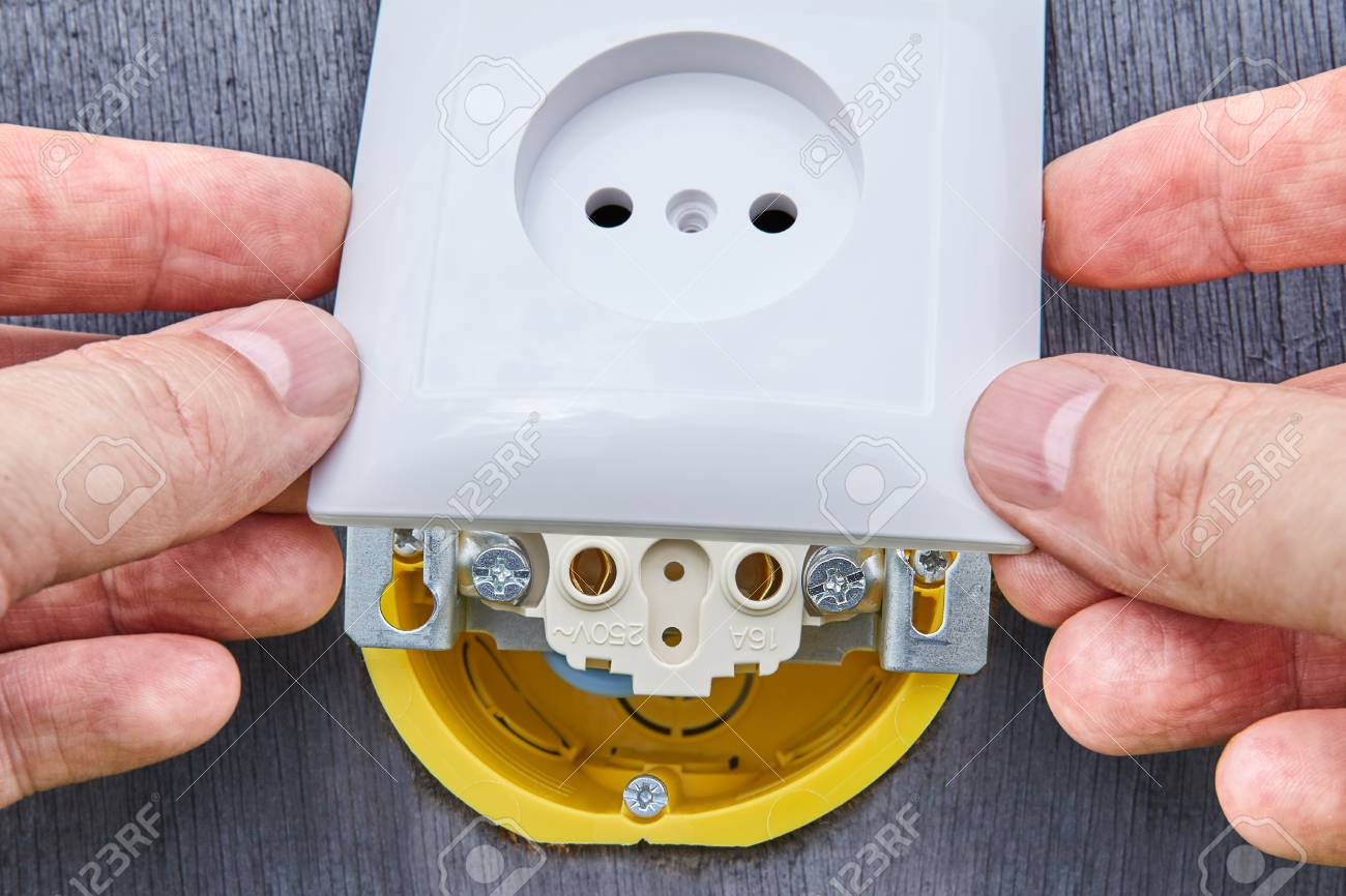 hight resolution of foto de archivo repairs of home electrical wiring replacement wall power outlet