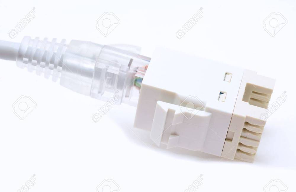 medium resolution of gray ethernet cat5e cable plugs to the rj45 keystone on a white background stock photo