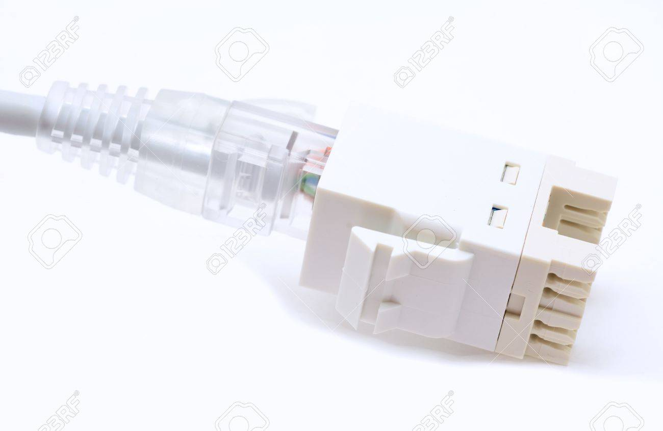 hight resolution of gray ethernet cat5e cable plugs to the rj45 keystone on a white background stock photo