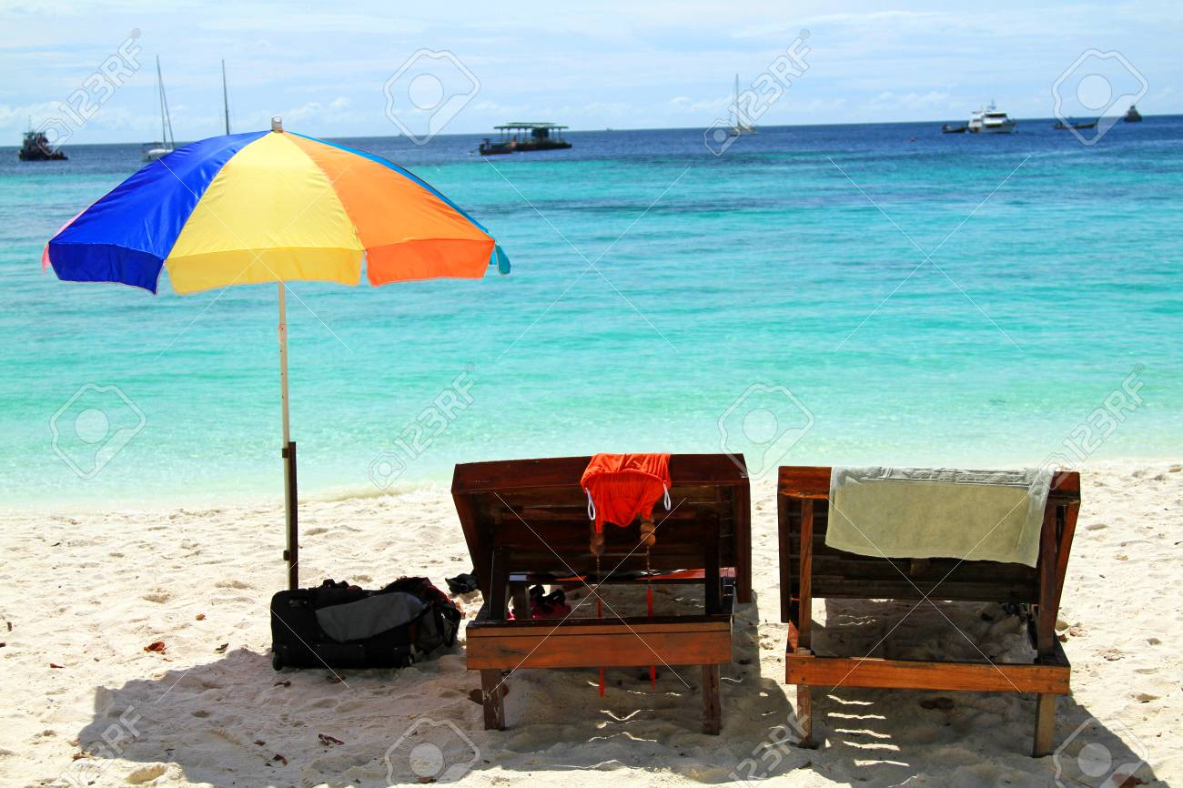 beach chairs and umbrella swivel outdoor two bikini on white sand with stock photo beautiful sea at koh lipe satun thailand