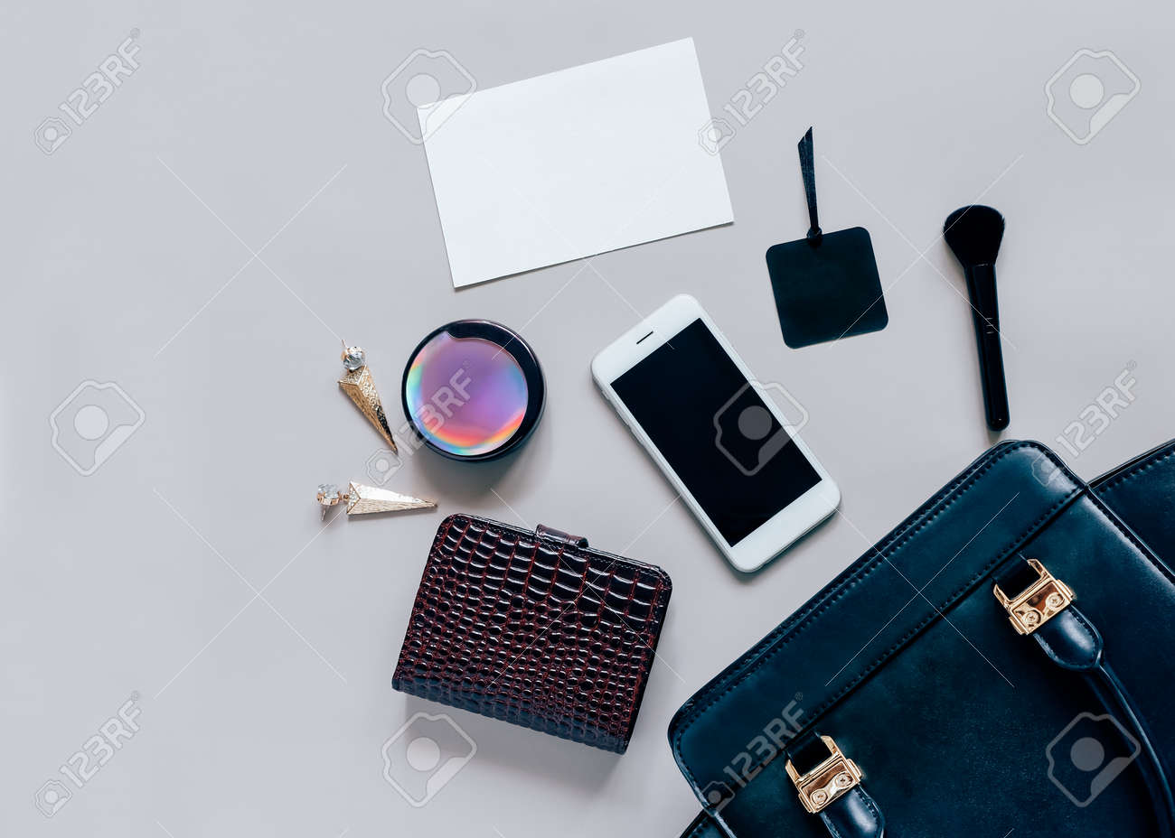 hight resolution of flat lay of black leather woman bag open out with cosmetics accessories wallet