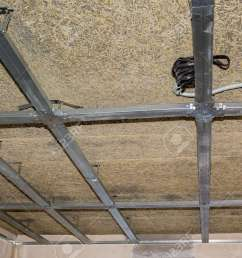 frame of suspended ceiling electrical wiring and fiberboard stock photo 46392884 [ 1300 x 866 Pixel ]