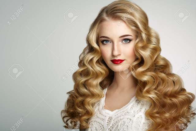 beautiful girl with long wavy and shiny hair . blonde woman with..