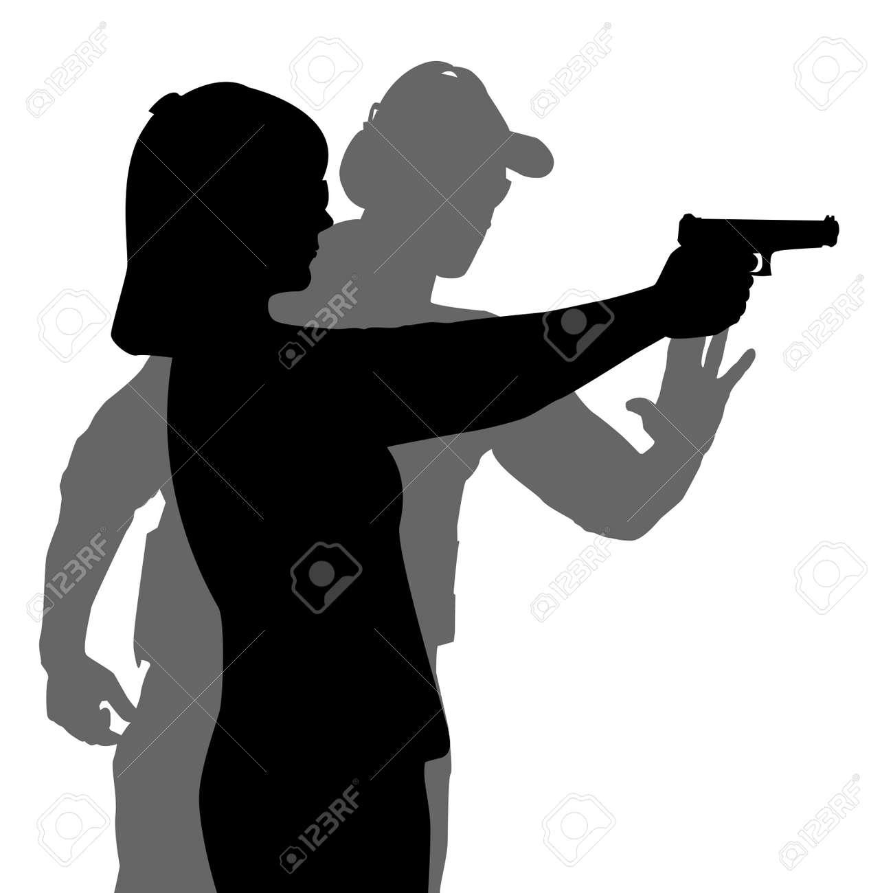 hight resolution of instructor assisting woman aiming hand gun at firing range