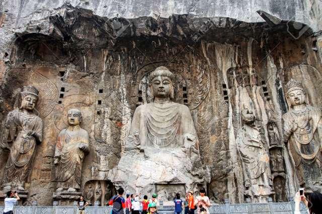 Henan Luoyang: Longmen Grottoes Fengxian Temple Rocana Buddha ...