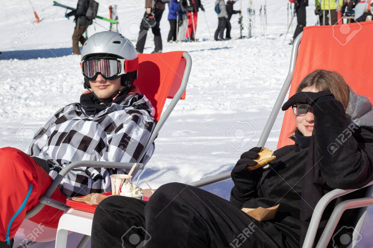 teenage girl and boy relaxing and having a break from skiing stock photo picture and royalty free image image 118585789