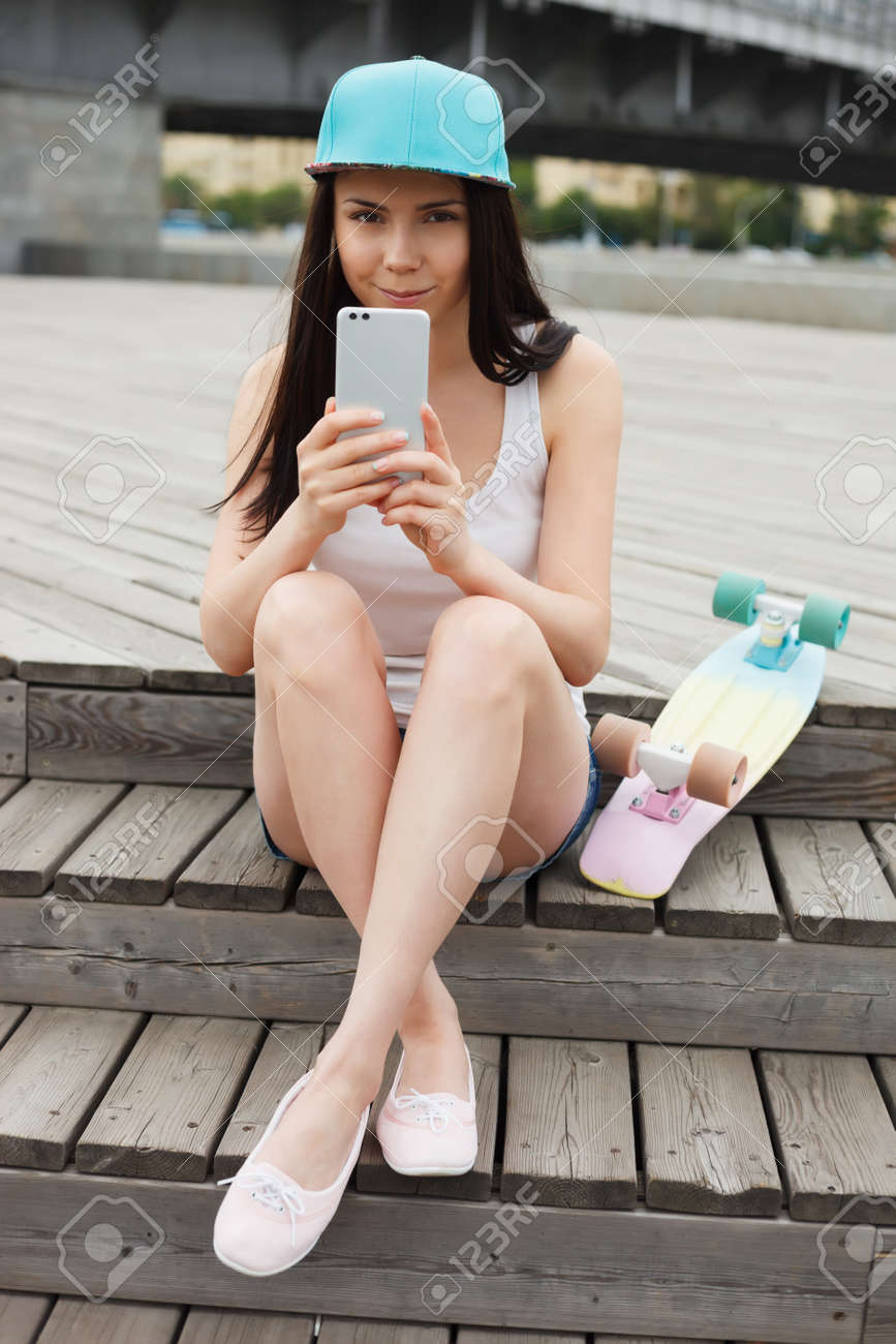 Pretty Young White Girl Taking Photo With Big Modern Smartphone With Dual Rear Camera Stock