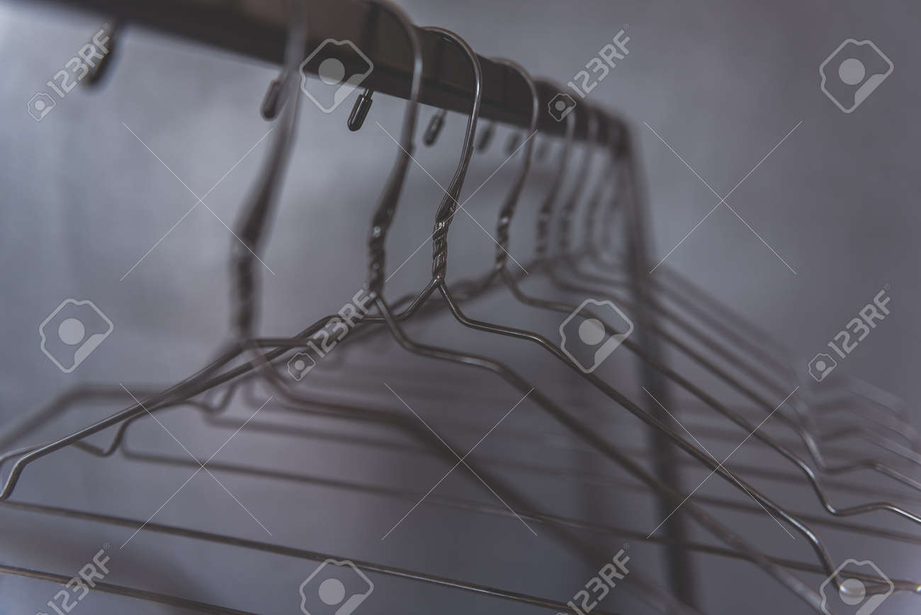 empty hangers are hanging