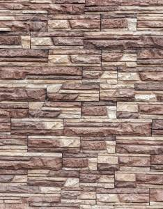 Decorative wall of artificial torn stone in brown tones masonry geometric pattern as also rh rf
