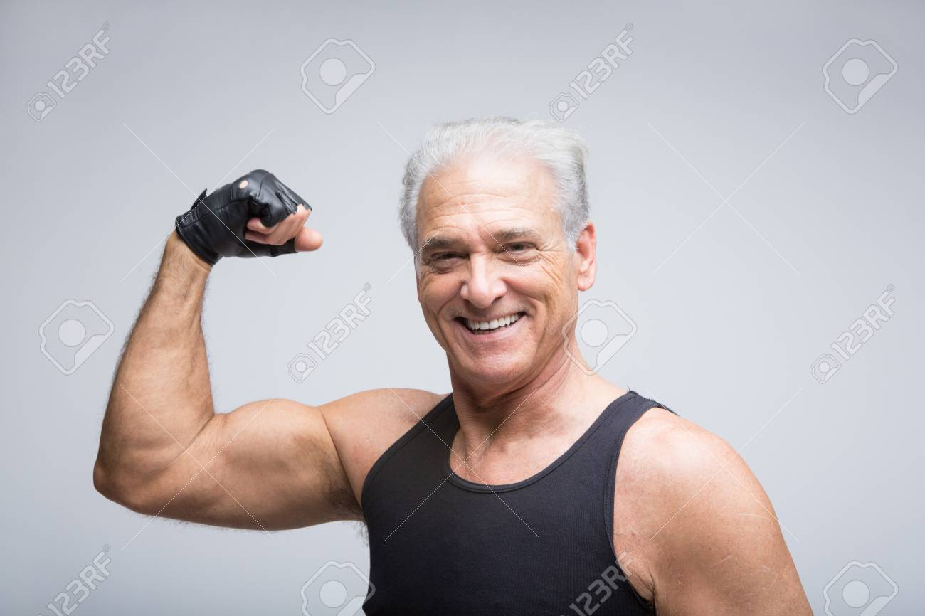 senior man flexing muscle