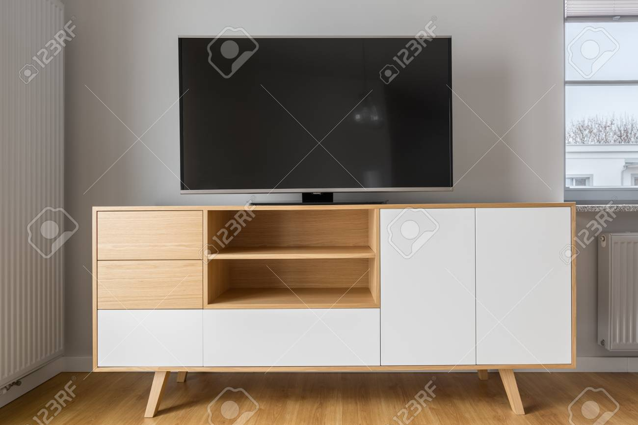 Big Tv Screen On Stylish White And Wood Cabinet Stock Photo Picture And Royalty Free Image Image 73765706