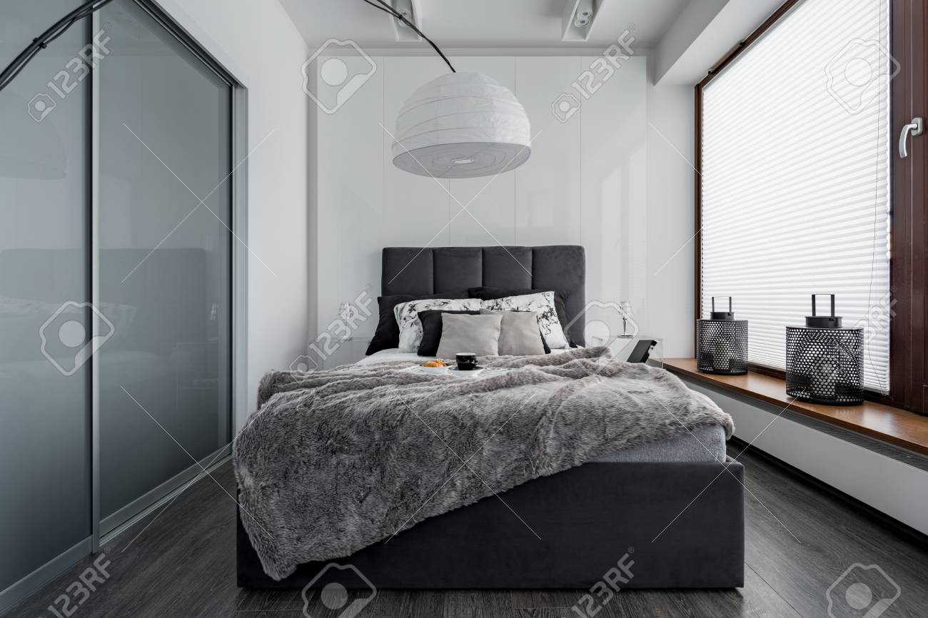gray and white bedroom with double bed modern lamp and sliding stock photo picture and royalty free image image 87418224