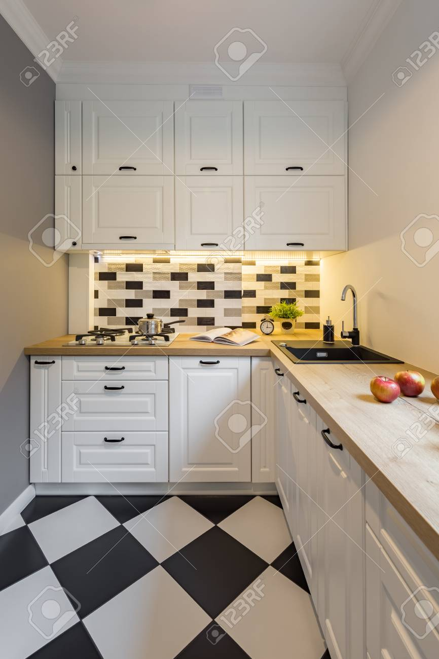 small kitchen with modern black and white floor tiles stock photo picture and royalty free image image 89766605