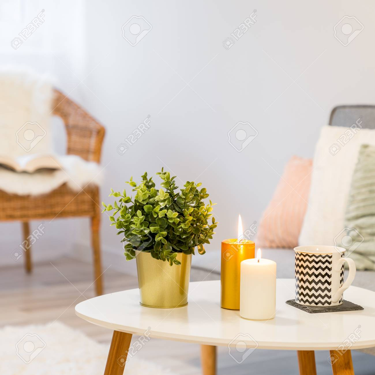 https www 123rf com photo 105300211 candles and plant standing on white coffee table in scandinavian style html