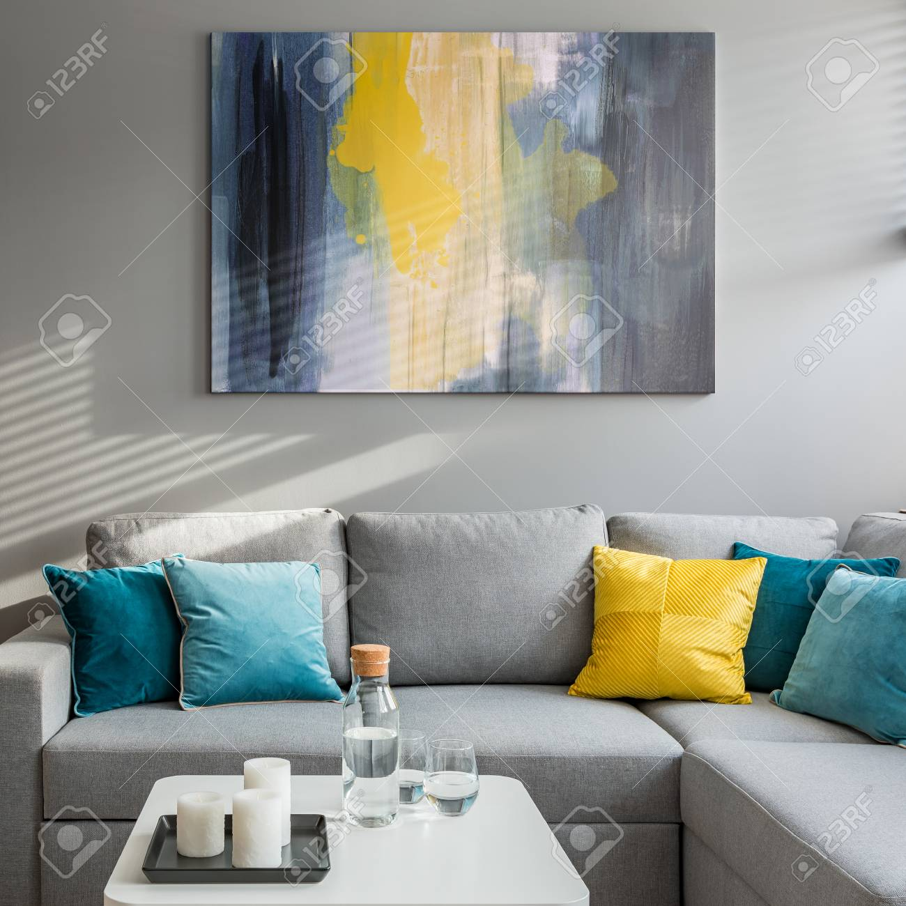 living room with corner sofa colorful cushions and white coffee stock photo picture and royalty free image image 108425895
