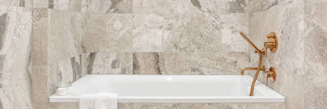 panorama of stylish white bathtub in bathroom with beige marble stock photo picture and royalty free image image 153702774