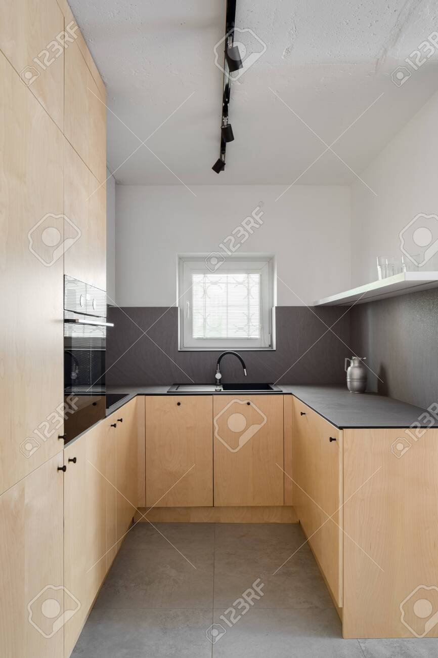stylish kitchen with birch veneer furniture gray floor tiles stock photo picture and royalty free image image 156817477
