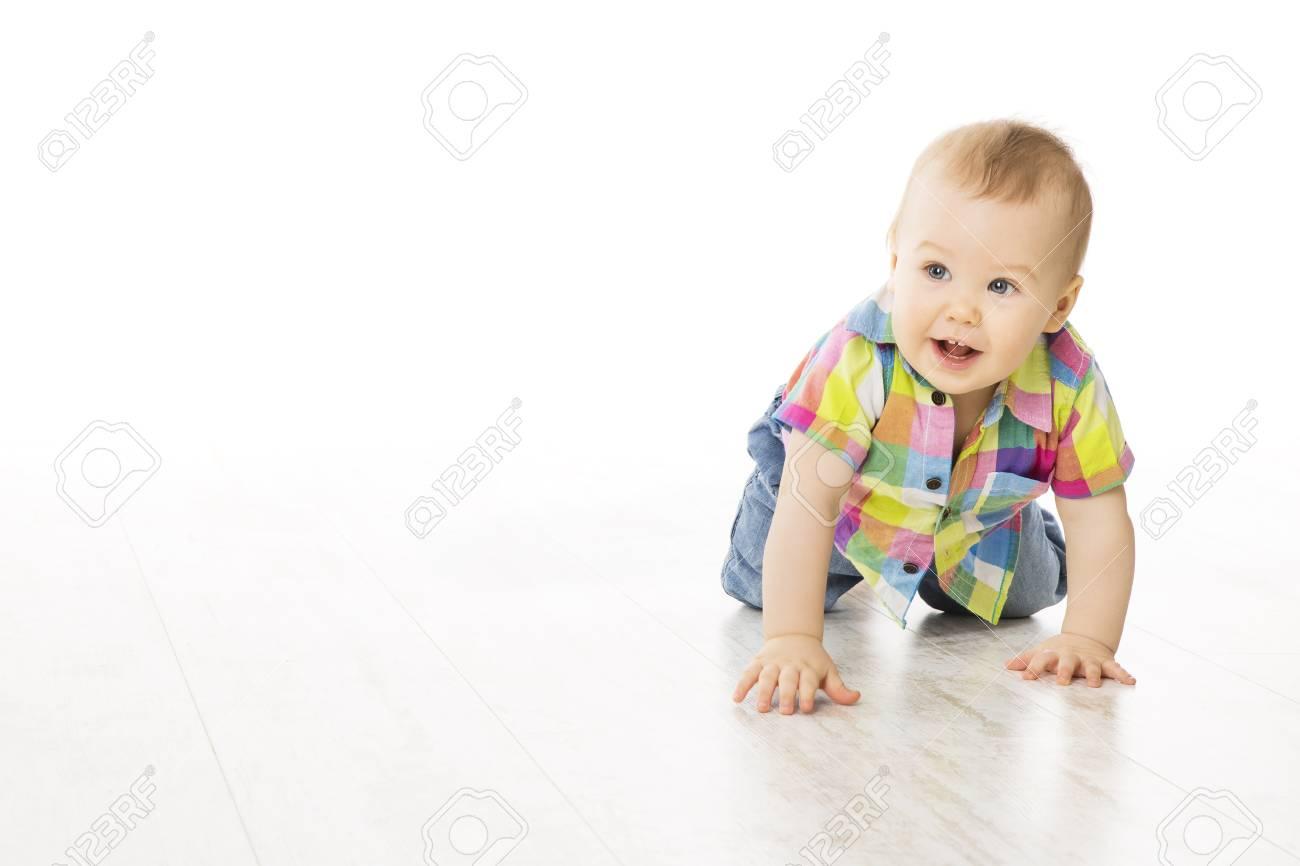 baby crawling on white