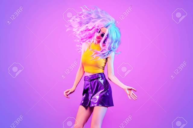 disco party doll girl with purple hairstyle having fun dance