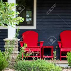 Red Adirondack Chairs Chair Covers Rentals Calgary Two Sit On A Front Porch Beach House Waiting Stock Photo For Someone To Back And Relax