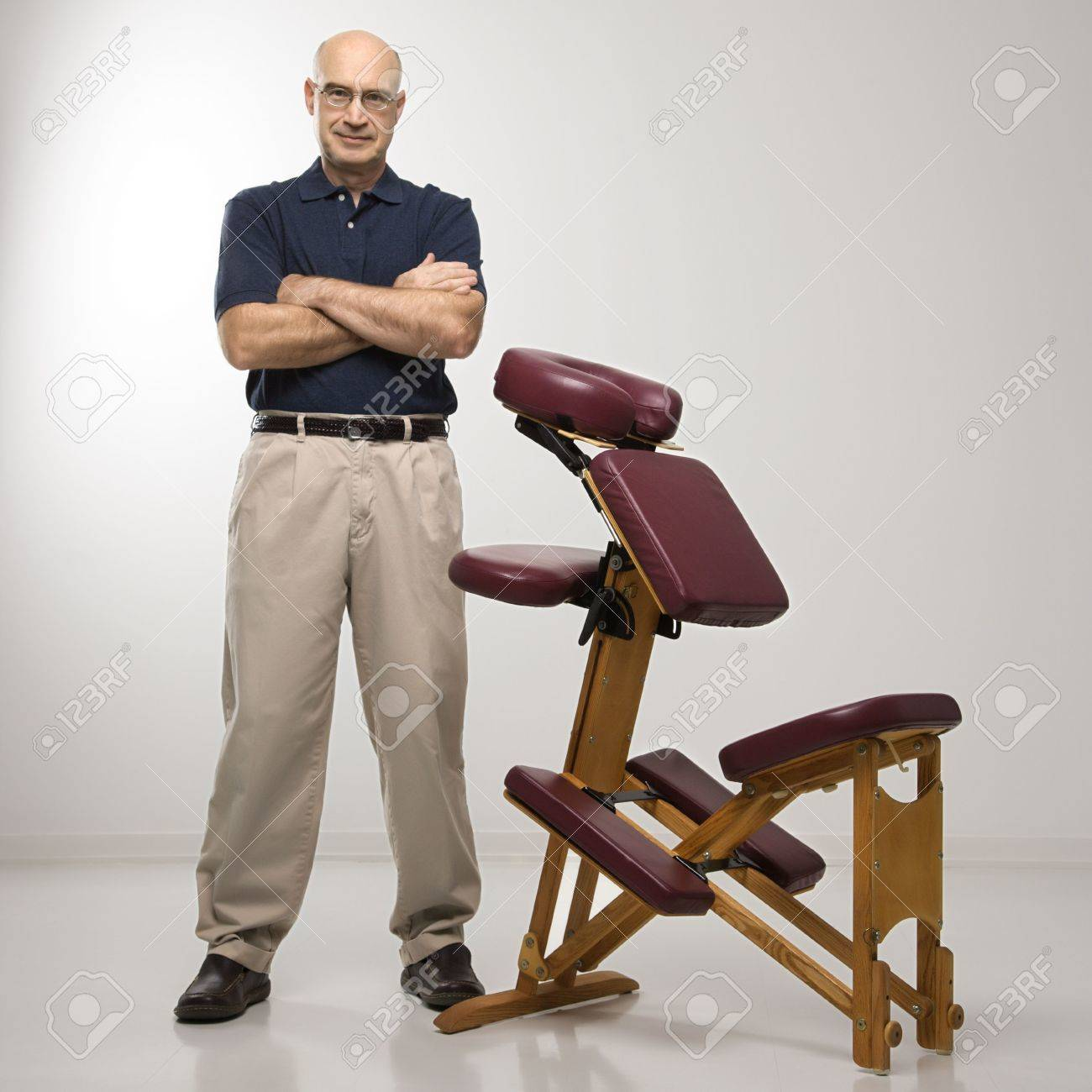 Massage Therapist Chair Caucasian Middle Aged Male Massage Therapist Standing With Arms