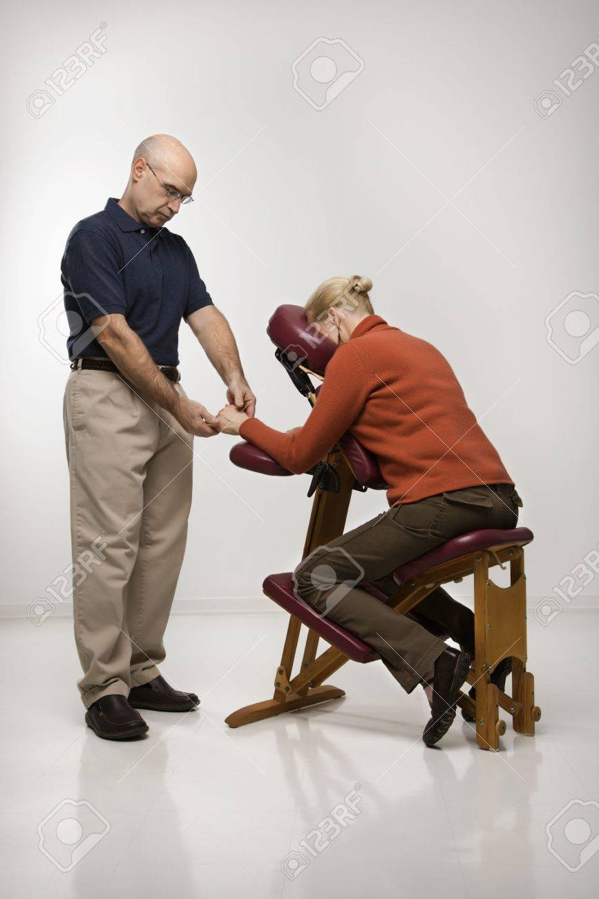 Massage Therapist Chair Caucasian Middle Aged Male Massage Therapist Massaging Hands