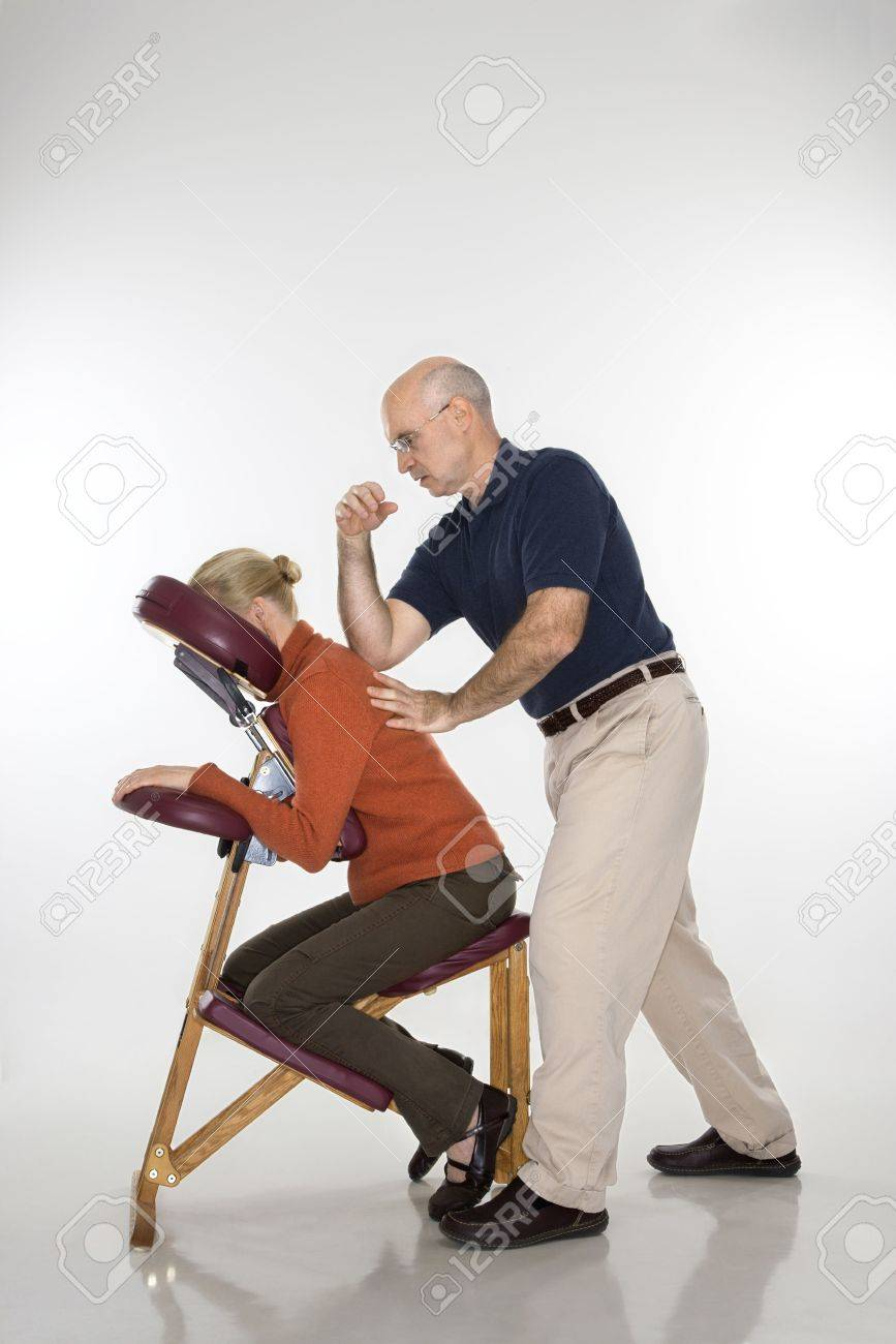 Massage Therapist Chair Caucasian Middle Aged Male Massage Therapist Massaging Back Of