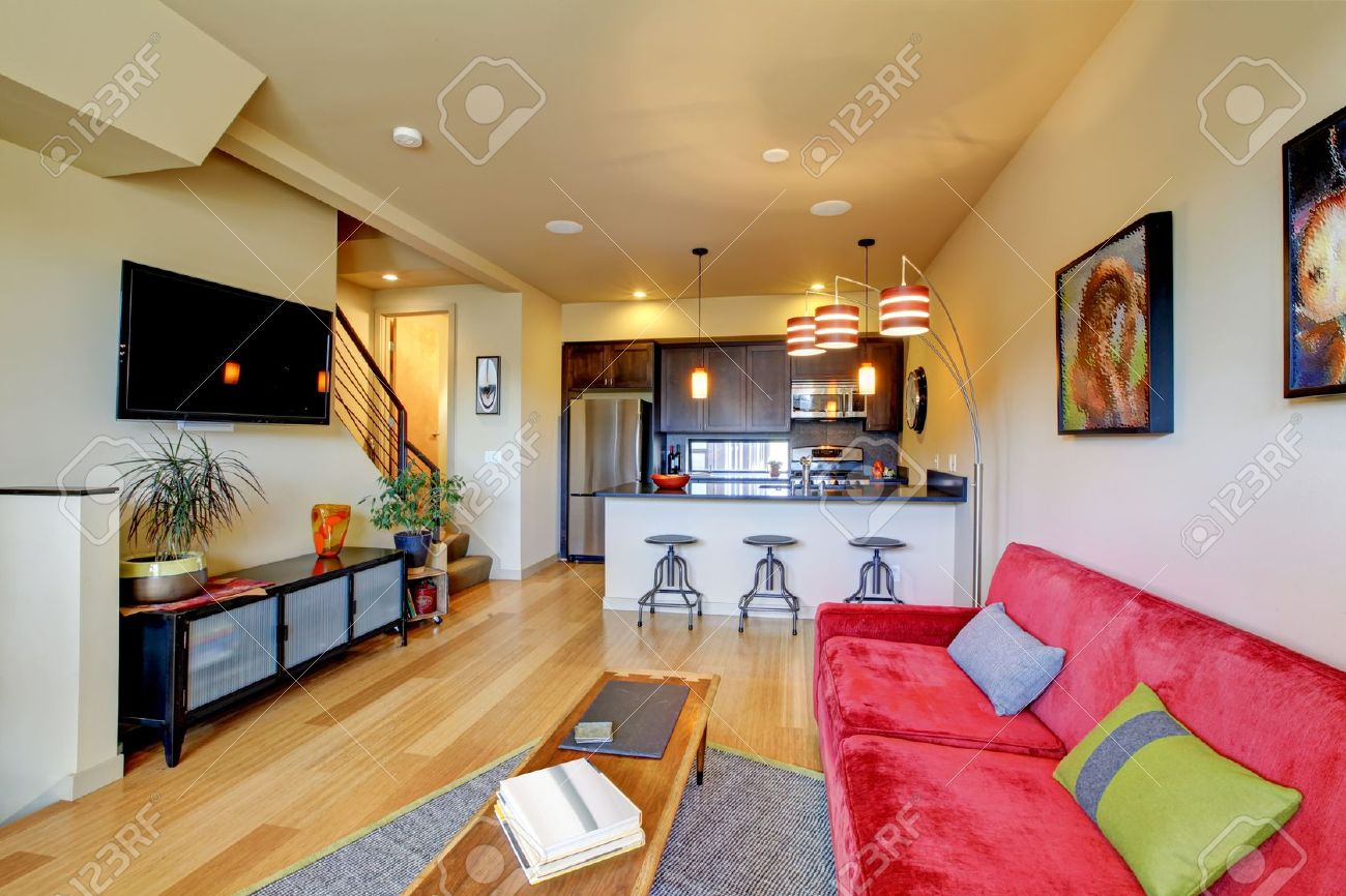 large living room sofas luxury furniture collection yellow with red sofa and brown kitchen stock photo