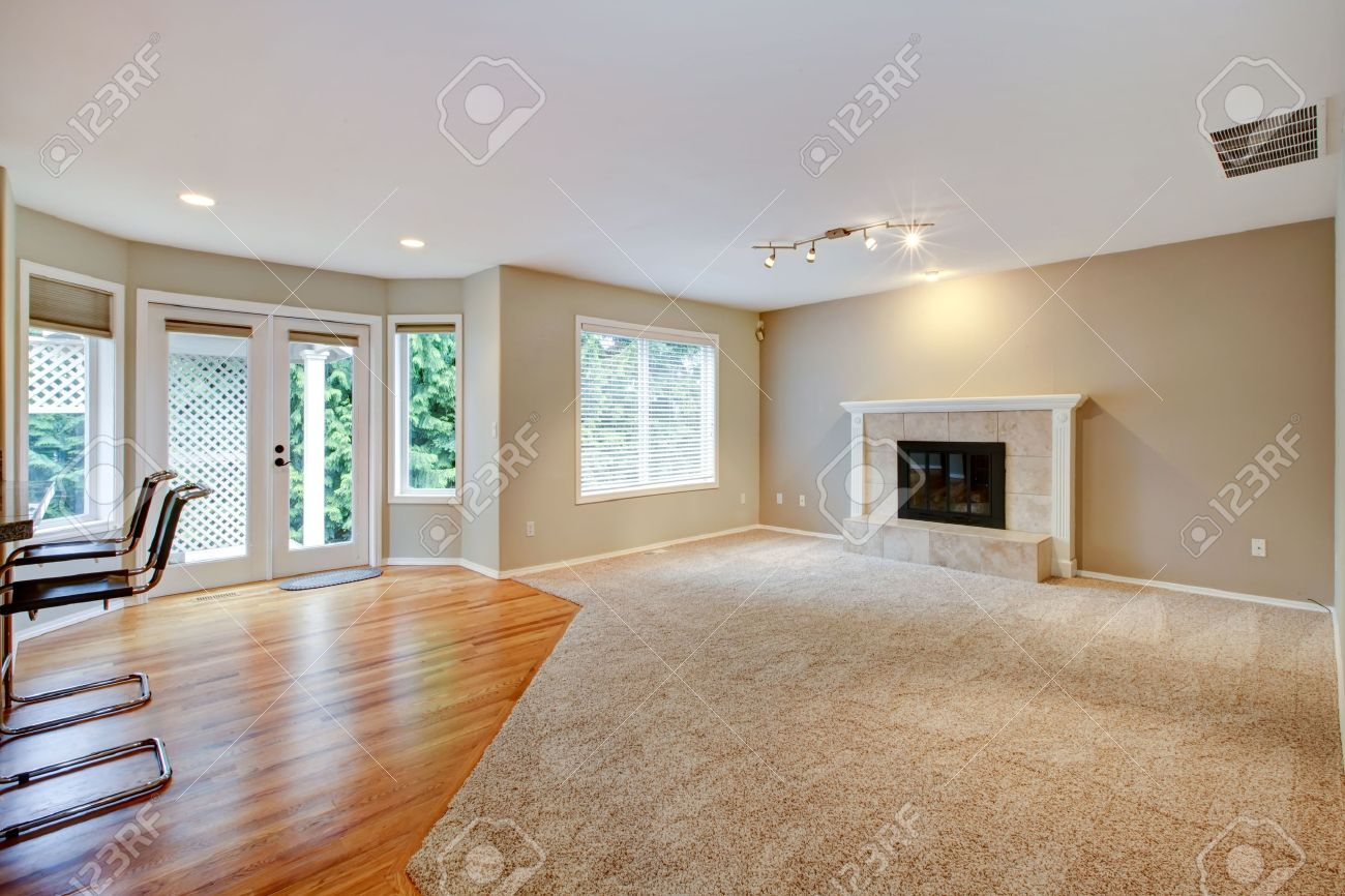 living room with carpet furniture entertainment center large bright empty new fireplace and beige stock photo 15960584