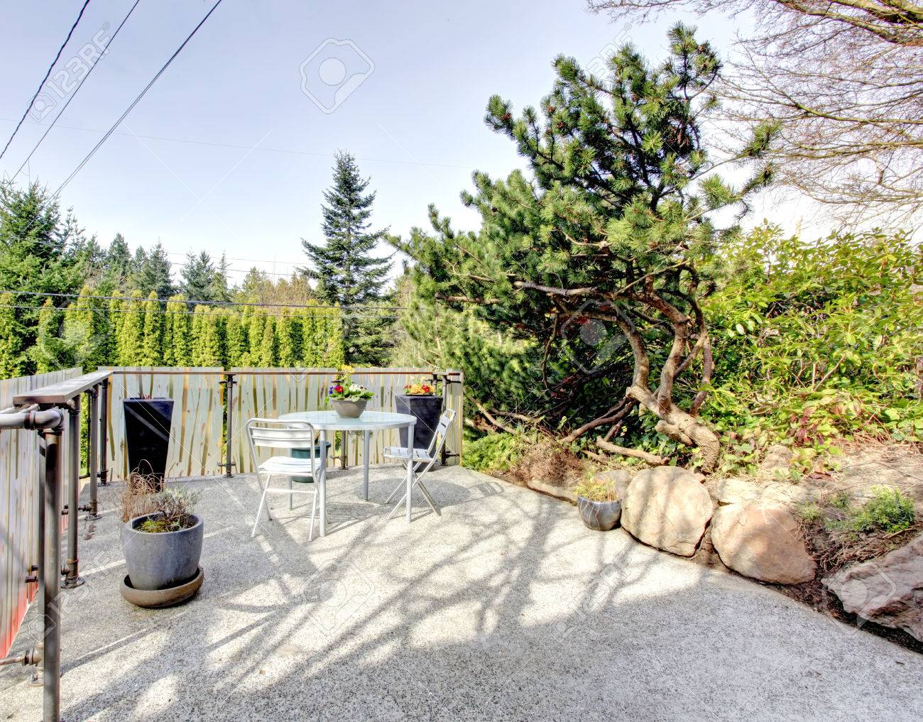 roof top deck over garage with a concrete floor and patio table stock photo picture and royalty free image image 26451084
