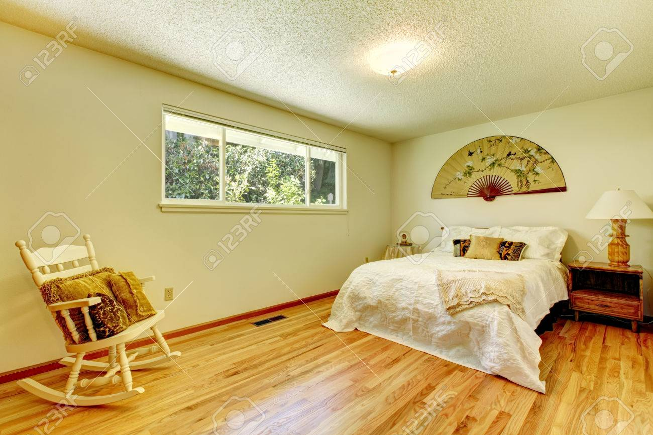 bedroom rocking chair electric power light tones with hardwood floor bed and room decorated asian