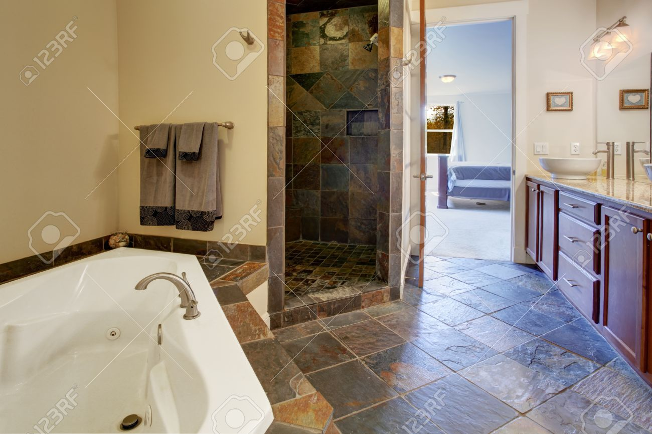 bathroom interior with dark tile floor and tile shower trim stock photo picture and royalty free image image 30131691