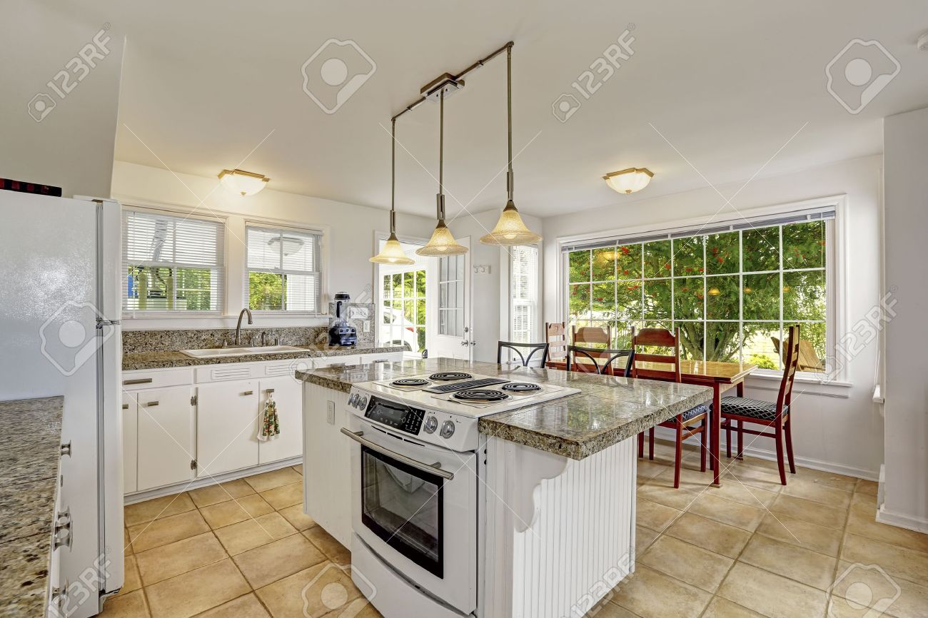 white kitchen room with granite tops kitchen island with built in