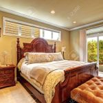 Luxury Bedroom With Carved Wood Bed Nightstand Ottoman And Stock Photo Picture And Royalty Free Image Image 32699235