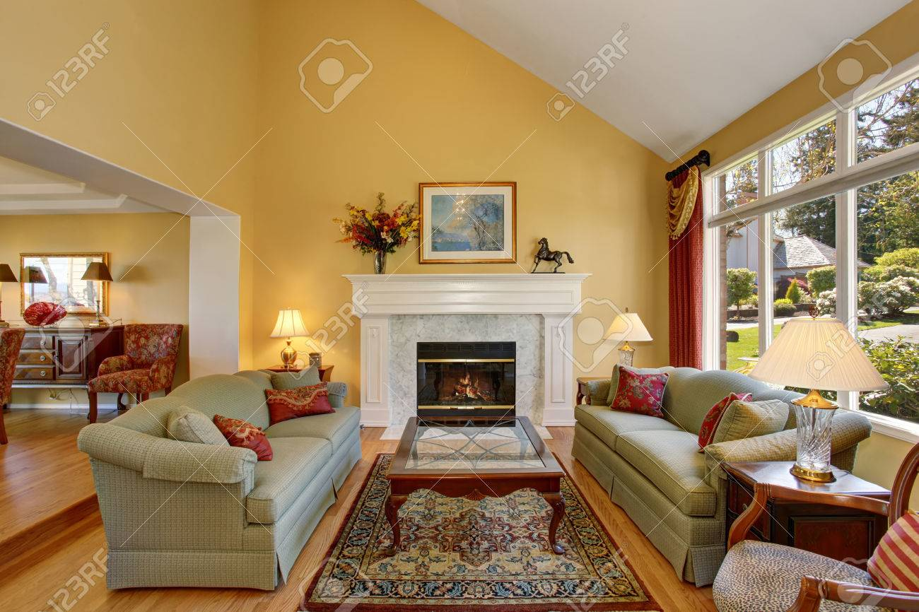 elegant living rooms with fireplaces wall lights for room ideas interior gray sofas red pillows and white fireplace create comfort