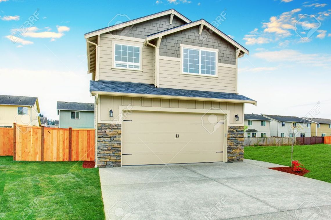 American Garage Home - 60410173-american-house-exterior-with-beige-trim-garage-with-concrete-driveway-and-brown-fence-with-well-kept_Most Inspiring American Garage Home - 60410173-american-house-exterior-with-beige-trim-garage-with-concrete-driveway-and-brown-fence-with-well-kept  Pictures_662426.jpg