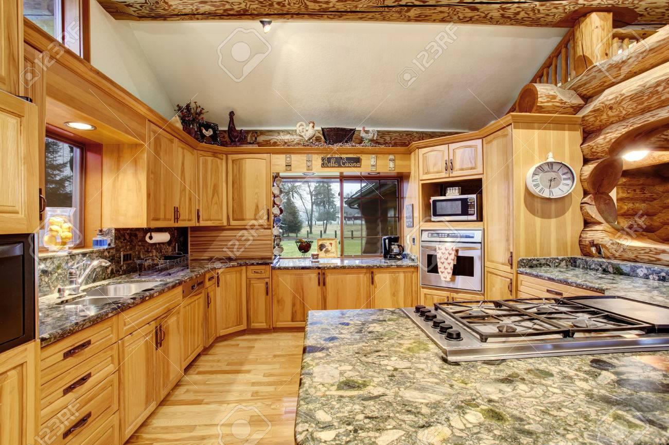 Log Cabin Kitchen Interior Design With Large Honey Color Storage