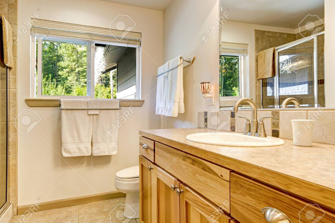 Bathroom Vanity Made Of Natural Wood And Reflection Of Glass Stock Photo Picture And Royalty Free Image Image 64690856