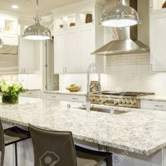 Large White Kitchen Island Red Valance Design Features Bar Style Stock Photo With Granite Countertop Illuminated By Modern Pendant Lights