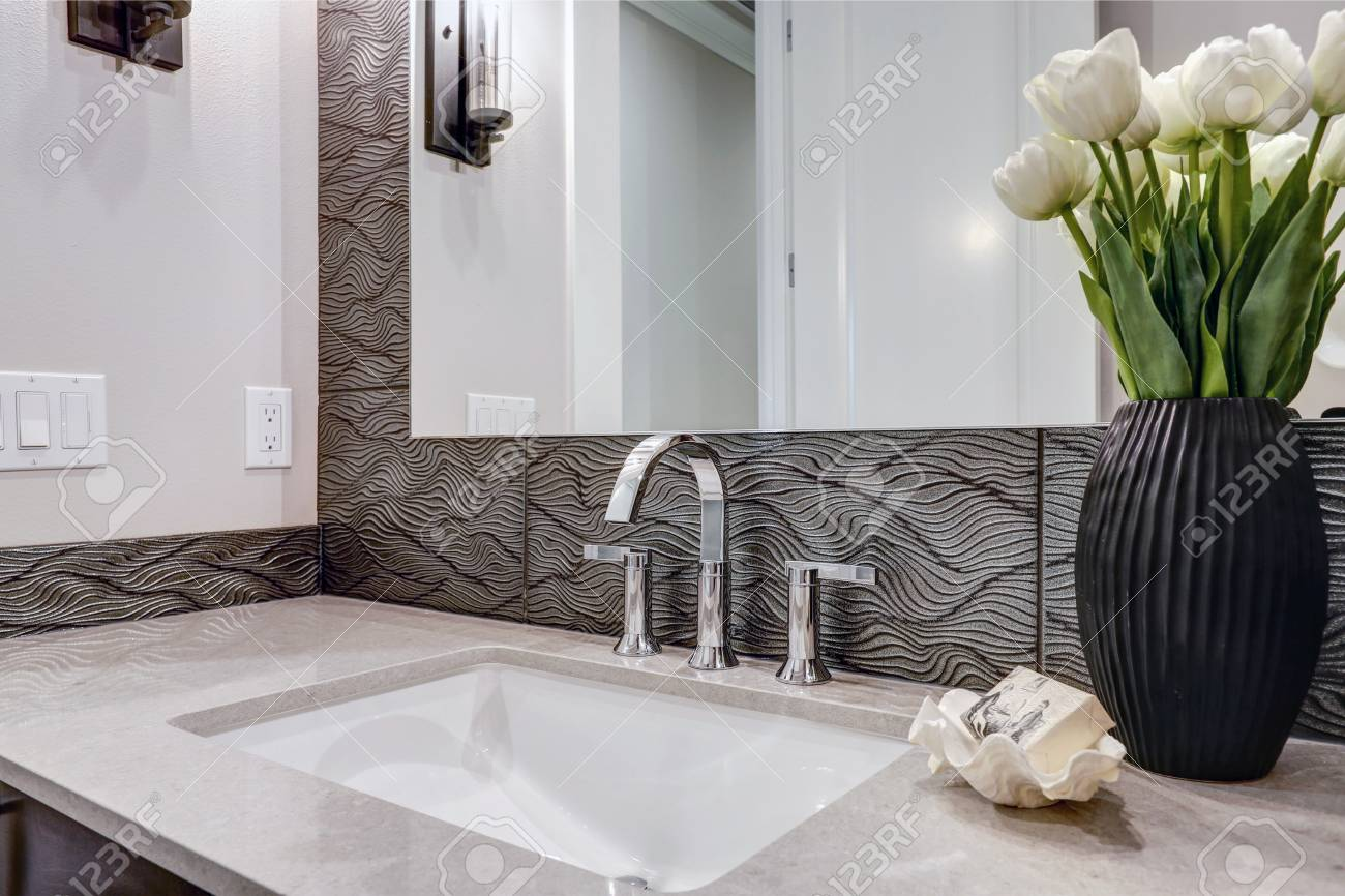 white and brown bathroom boasts a nook filled with a taupe vanity stock photo picture and royalty free image image 93635170
