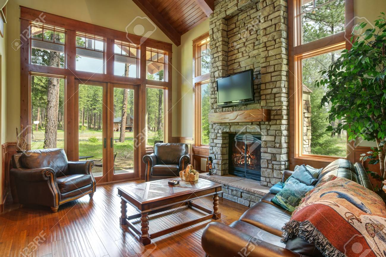 Stunning Living Room Design Includes A Stone Wall Fireplace