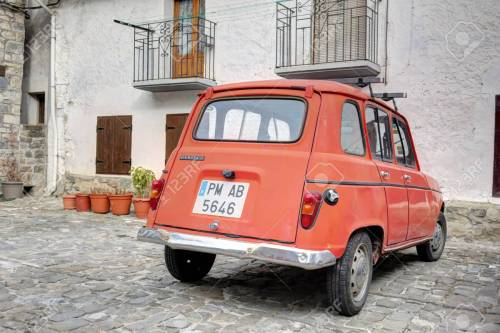 small resolution of an old traditional renault 4 tl red car parked in the stone square of the rural