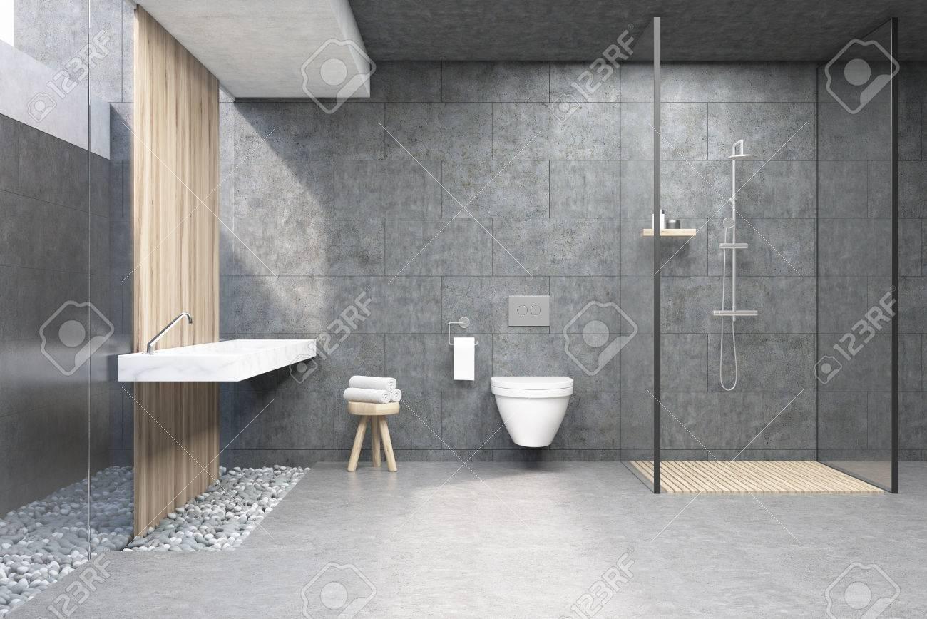 interieur de la salle de bain avec des murs gris une cabine de douche avec paroi en verre une toilette et un double lavabo rendu 3d