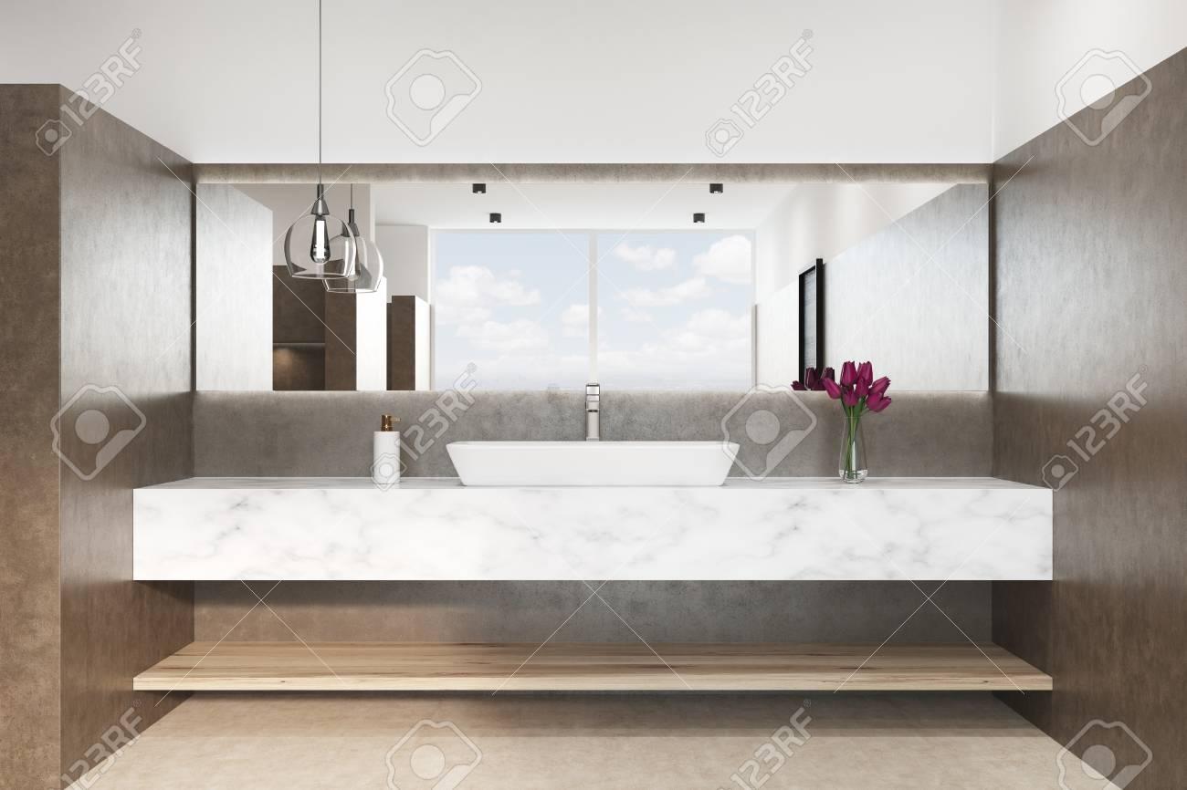 gros plan d un interieur de salle de bain marron avec un sol blanc un lavabo en marbre et une lampe originale fleurs dans un vase vue de face