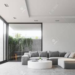 Living Room Round Table False Ceiling Designs For India Interior With A Concrete Floor Gray Sofa And