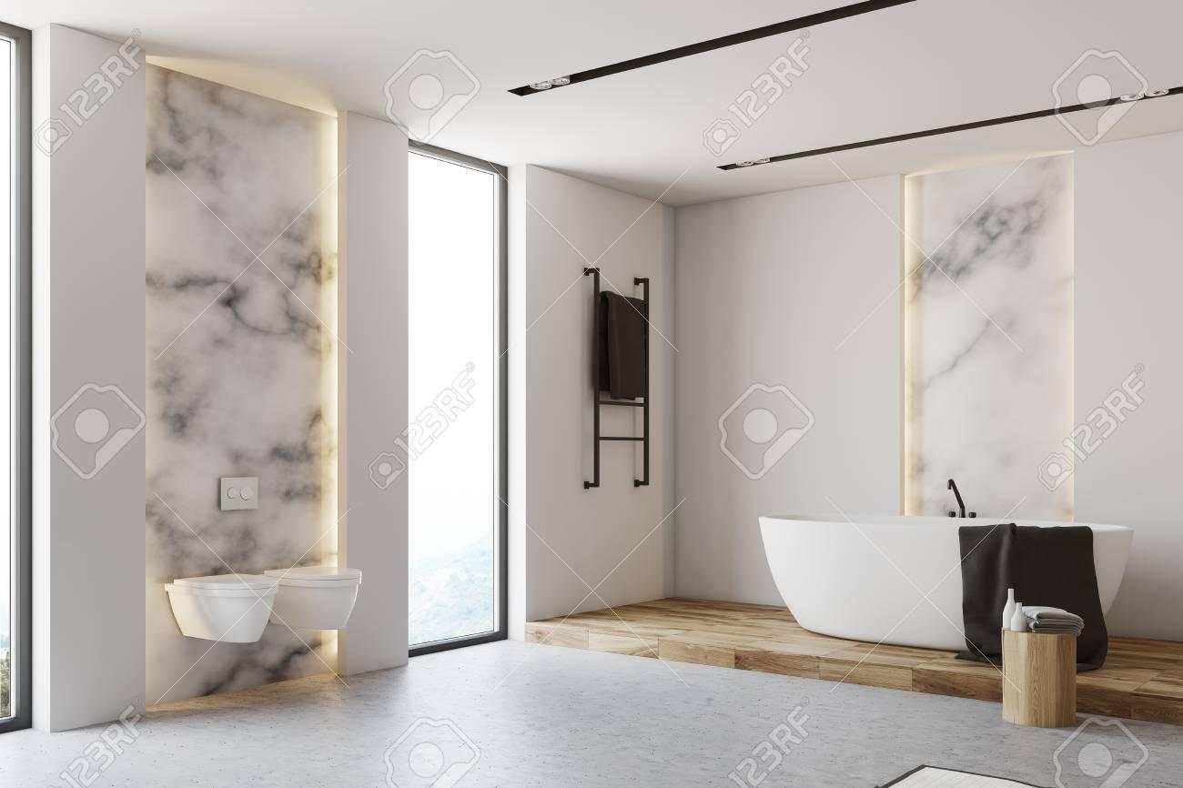 coin salle de bain en marbre blanc avec sol gris baignoire blanche deux toilettes et une grande fenetre rendu 3d